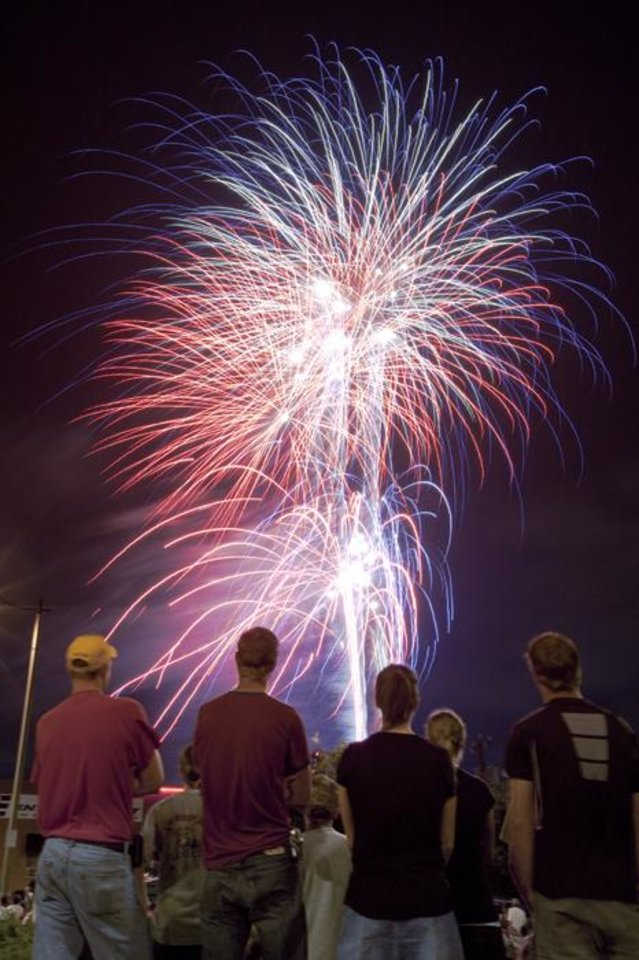 Photo -  Spectators watch a fireworks display during the Independence Day celebration Red, White, and Boom! east of the AT&T Bricktown Ballpark in Oklahoma City, Saturday, July 3, 2010. Photo by Nate Billings, The Oklahoman