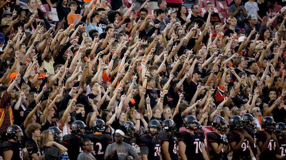 Photo - Norman fans cheer during the high school football game between Norman North and Norman at the Gaylord Family-Oklahoma Memorial in Norman, Okla.,  Thursday, Sept. 5, 2019. [Sarah Phipps/The Oklahoman]