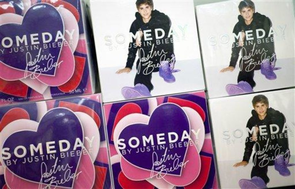 In this Aug. 23, 2012, photo, Someday fragrance from the Justin Bieber collection is displayed at a Lord & Taylor department store in New York. Celebrities have long dabbled in design, but with the growth of TV shows and websites that follow everything celebrities say, wear and do, interest in their clothing lines has risen in recent years. North America revenue from celebrity clothing lines, excluding merchandise linked to athletes, rose 6 percent last year to an historic peak of $7.58 billion in 2011, according to the latest figures available by The Licensing Letter, an industry trade. That's on top of a nearly 5 percent increase in 2010. (AP Photo/Mark Lennihan)