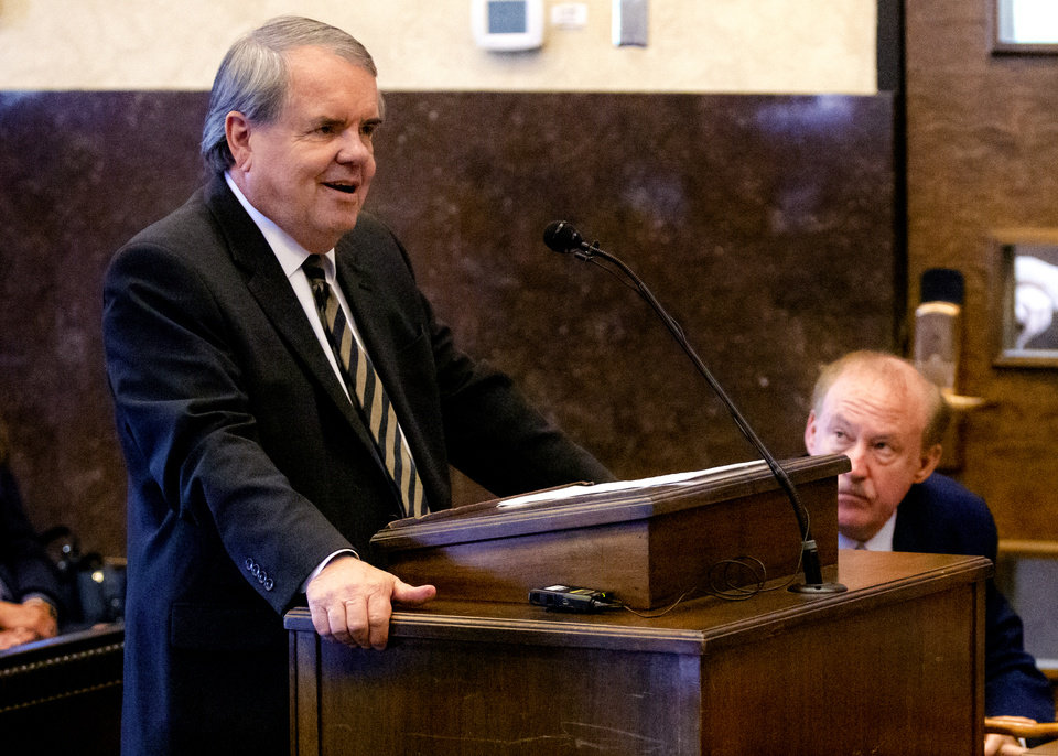 Photo - State's attorney Michael Burrage speaks during the hearing to settle the Journal Entry of Judgment for opioid trial at the Cleveland County Courthouse in Norman, Okla. on Tuesday, Oct. 15, 2019. Judge Balkman ruled last Aug. in favor of the State of Oklahoma, for Johnson and Johnson pay $572 million to a plan to abate the opioid crisis.  [Chris Landsberger/The Oklahoman]