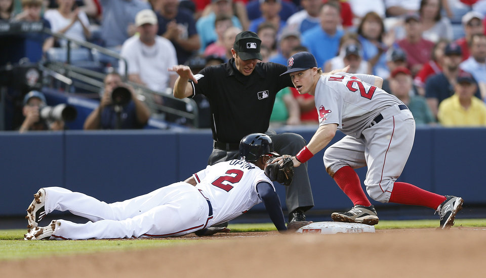 Photo - Atlanta Braves' B.J. Upton (2) is safe at third base after over running the bag on a base hit by his brother, Justin Upton, as Boston Red Sox third baseman Brock Holt (26) applies the late tag in the third inning of a baseball game Tuesday, May 27, 2014, in Atlanta. (AP Photo/John Bazemore)