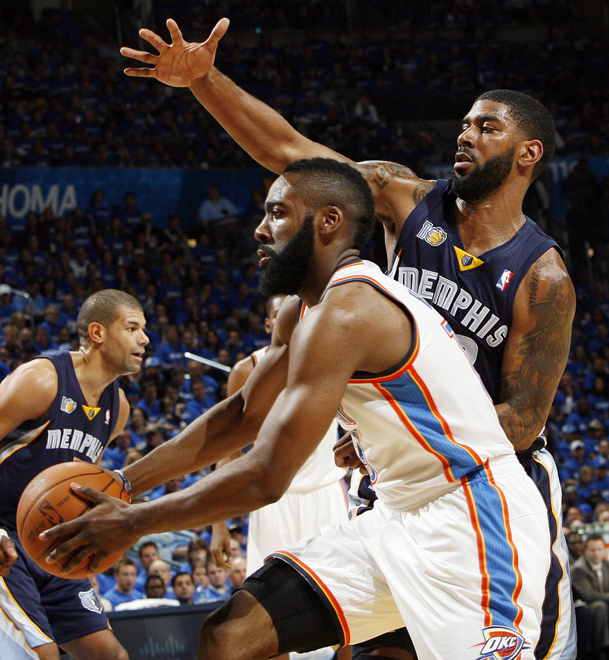 Photo - Oklahoma City's James Harden (13) takes the ball past O.J. Mayo (32) of Memphis in the first half during game one of the Western Conference semifinals between the Memphis Grizzlies and the Oklahoma City Thunder in the NBA basketball playoffs at Oklahoma City Arena in Oklahoma City, Sunday, May 1, 2011. At left in the background is Shane Battier (31) of Memphis. Photo by Nate Billings, The Oklahoman