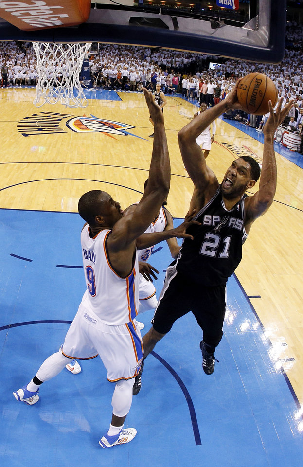 Photo - San Antonio's Tim Duncan (21) shoots against Oklahoma City's Serge Ibaka (9) during Game 6 of the Western Conference Finals in the NBA playoffs between the Oklahoma City Thunder and the San Antonio Spurs at Chesapeake Energy Arena in Oklahoma City, Saturday, May 31, 2014. Photo by Nate Billings, The Oklahoman