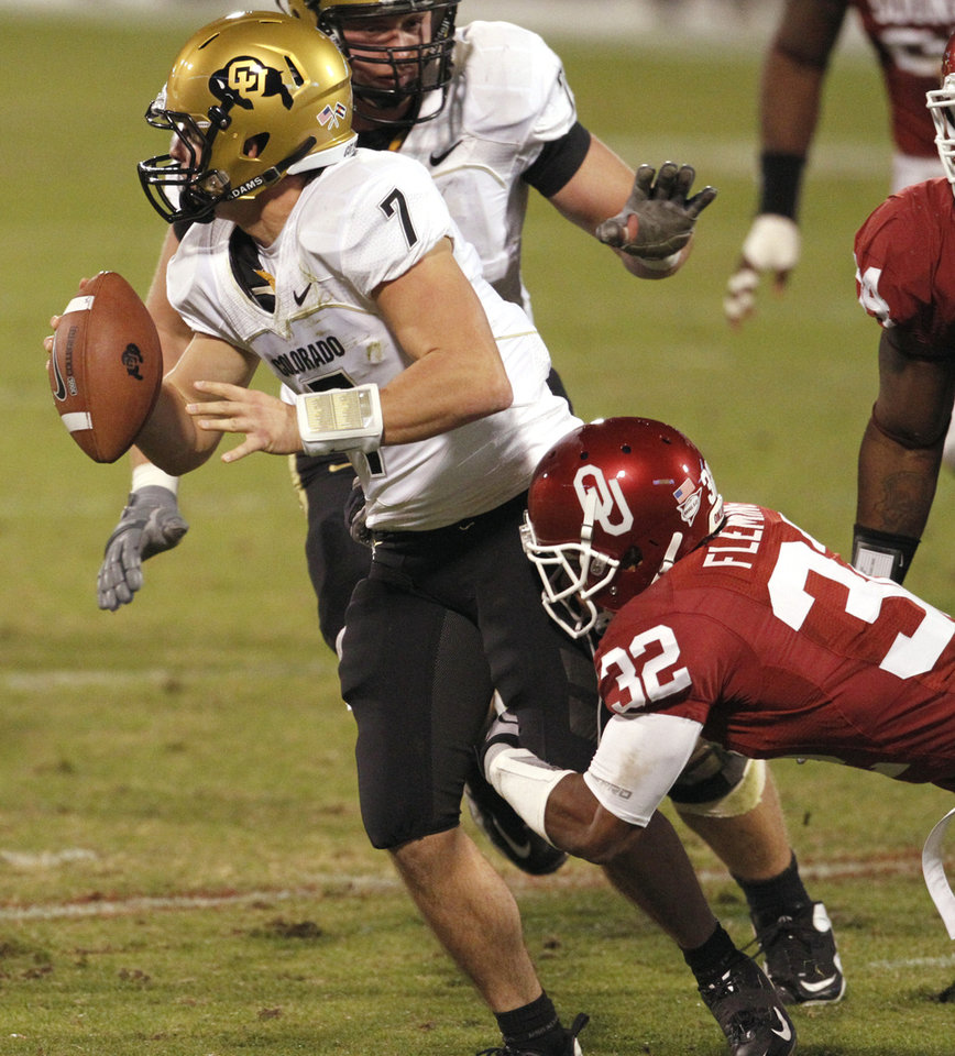 Photo - Jamell Fleming (32) forces quarterback Cody Hawkins to throw a pass to no one resulting in a intentional grounding penalty during the first half of the college football game between the University of Oklahoma (OU) Sooners and the University of Colorado Buffaloes at Gaylord Family-Oklahoma Memorial Stadium in Norman, Okla., Saturday, October 30, 2010.  Photo by Steve Sisney, The Oklahoman