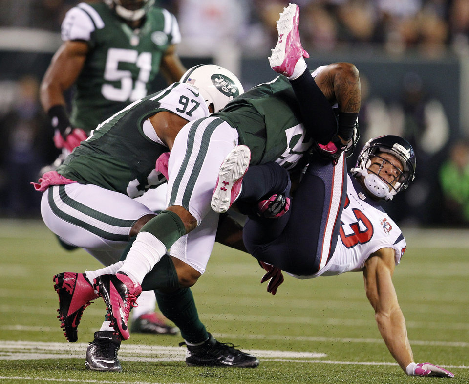 Photo -   New York Jets defensive back Ellis Lankster (26) tackles Houston Texans wide receiver Kevin Walter (83) during the first half of an NFL football game, Monday, Oct. 8, 2012, in East Rutherford, N.J. (AP Photo/Julio Cortez)