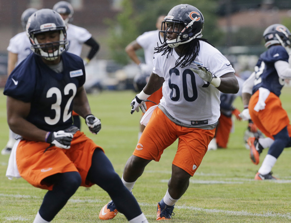 Photo - Chicago Bears linebacker Khaseem Greene (60) works with teammates during NFL football training camp Friday, July 26, 2013, at Olivet Nazarene University in Bourbonnais, Ill. (AP Photo/Nam Y. Huh)