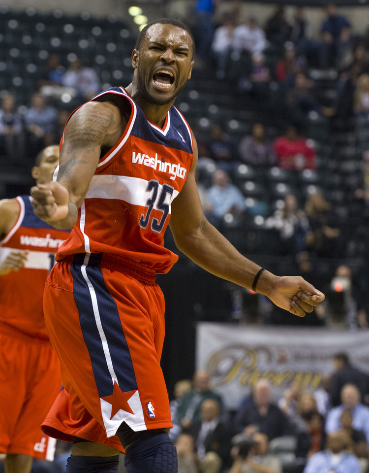Photo -   Washington Wizards power forward Trevor Booker (35) reacts toward officials after he felt he was fouled during first-half action in an NBA basketball game agansit the Indiana Pacers in Indianapolis, Saturday, Nov. 10, 2012. (AP Photo/Doug McSchooler)