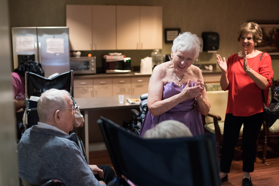 Photo -  Concordia resident Joan Quatro, right, claps after a dance with fellow residents before the facility's 10th anniversary gala. [PHOTO BY WHITNEY BRYEN, FOR THE OKLAHOMAN]