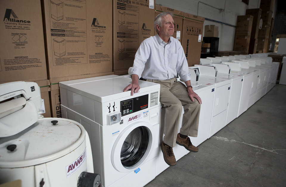 Photo - Steve Wyard, 61, a regional sales director of All Valley Washer Service, poses for photos recently in a warehouse in the Van Nuys section of Los Angeles.  AP Photo  Jae C. Hong