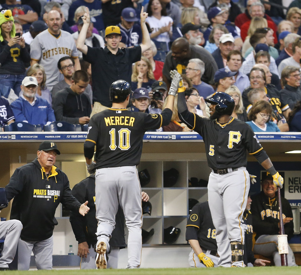 Photo - Pittsburgh Pirates' Jordy Mercer is congratulated by Josh Harrison as he returns to the dugout after a solo home run against the San Diego Padres during the third inning of a baseball game Monday, June 2, 2014, in San Diego. (AP Photo/Lenny Ignelzi)