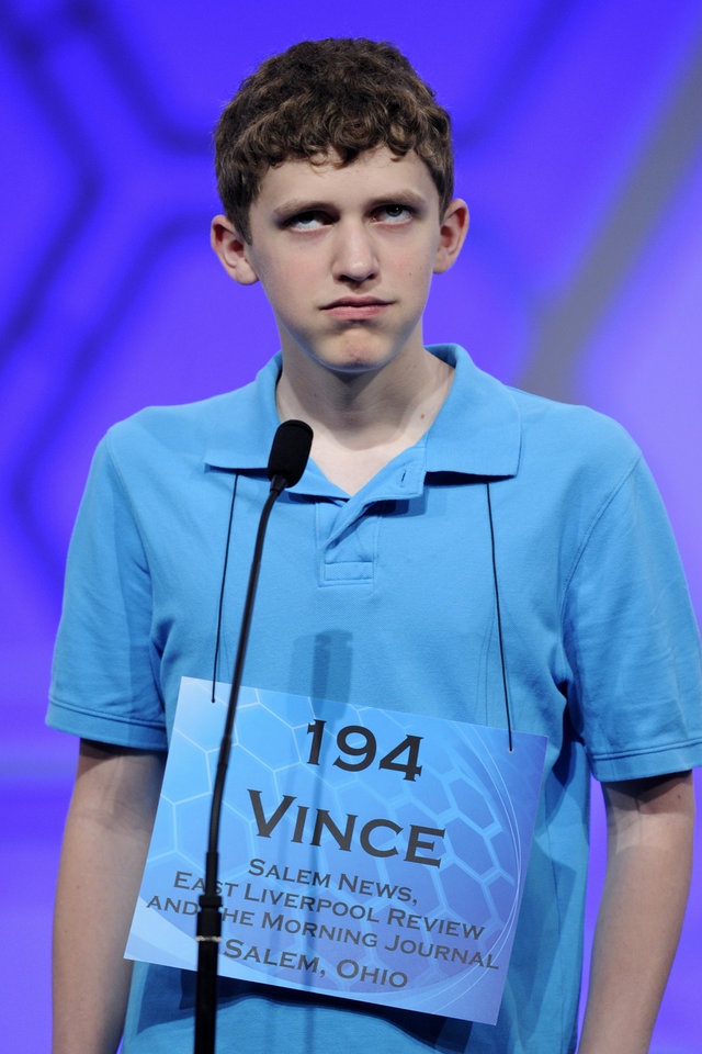 "Photo - Vince Hoppel, 13, of Salem, Ohio, spells the word ""curriculum"" during the 2015 Scripps National Spelling Bee in Oxon Hill, Md., Wednesday, May 27, 2015. (AP Photo/Cliff Owen)"