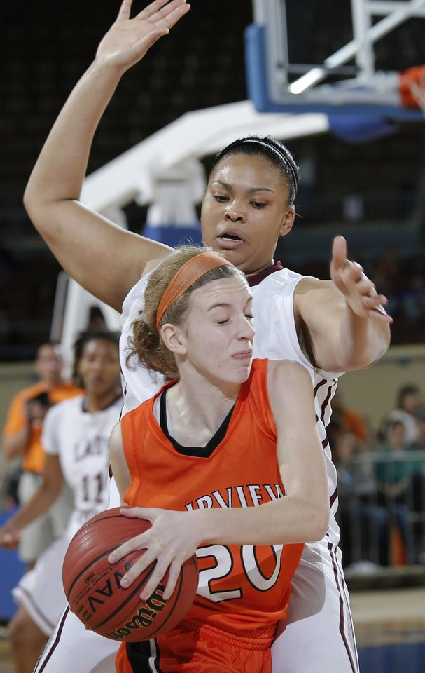 Northeast's Chanel Akins (33) defends on Fairview's Abby Smith 920) during the state high school basketball tournament Class 2A girls semifinal game between Fairview High School and Northeast High School at the State Fair Arena on Friday, March 8, 2013, in Oklahoma City, Okla. Photo by Chris Landsberger, The Oklahoman