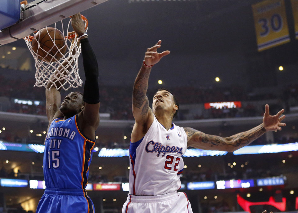 Photo - Oklahoma City's Reggie Jackson (15) dunks in front of Los Angeles' Matt Barnes (22) during Game 3 of the Western Conference semifinals in the NBA playoffs between the Oklahoma City Thunder and the Los Angeles Clippers at the Staples Center in Los Angeles, Friday, May 9, 2014. Photo by Nate Billings, The Oklahoman