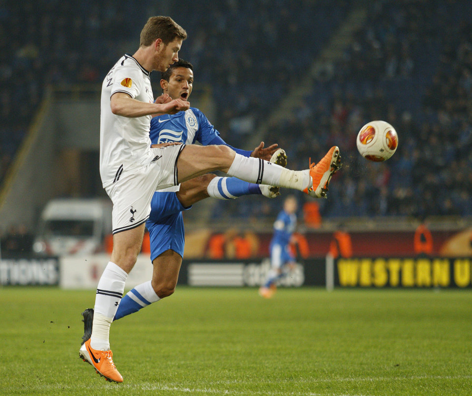 Photo - Tottenham's Jan Vertonghen, left, challenges for the ball against Matheus of Ukrainian Dnipro, during their UEFA Europa League round of 32, first leg soccer match at GSP Stadium in Dnipropetrovsk, Ukraine,Thursday, Feb. 20, 2014. (AP Photo/Sergei Kozin)