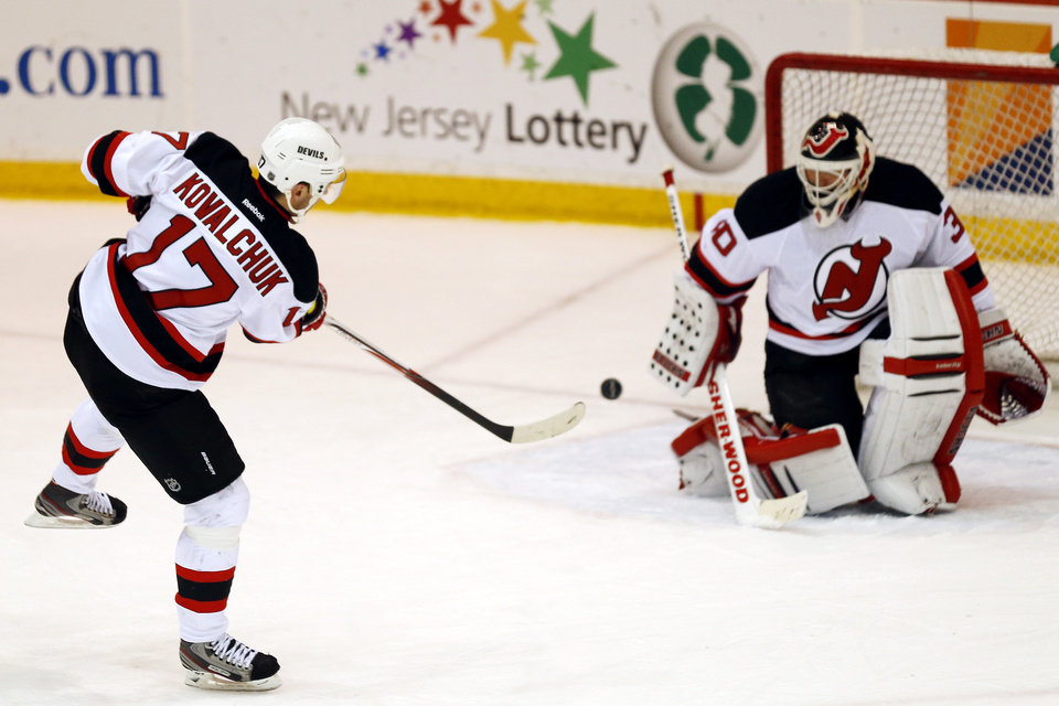New Jersey Devils left wing Ilya Kovalchuk (17), of Russia, takes a shot against goalie Martin Brodeur (30) during a scrimmage on Wednesday, Jan. 16, 2013, in Newark, N.J. (AP Photo/Julio Cortez)