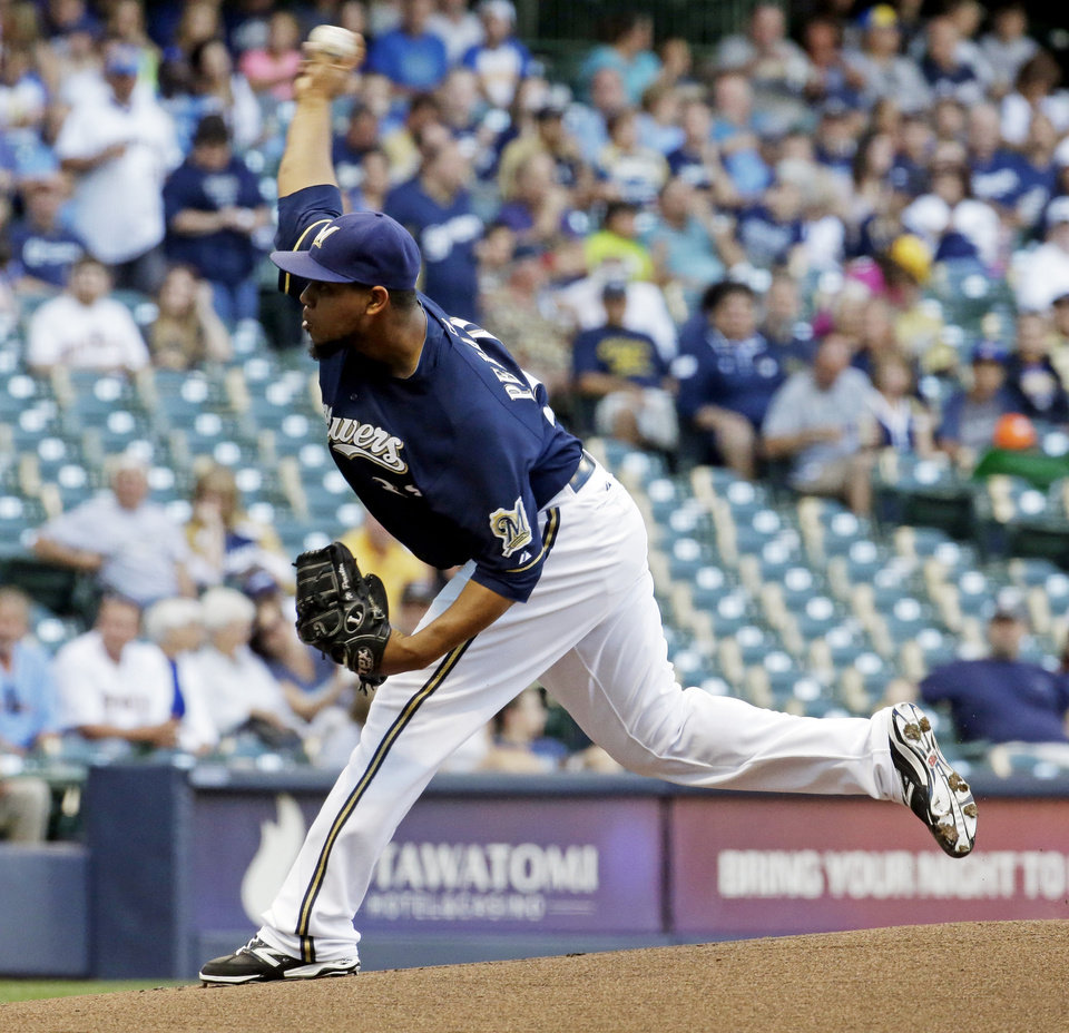 Photo - Milwaukee Brewers starting pitcher Wily Peralta throws during the first inning of a baseball game against the Philadelphia Phillies Tuesday, July 8, 2014, in Milwaukee. (AP Photo/Morry Gash)
