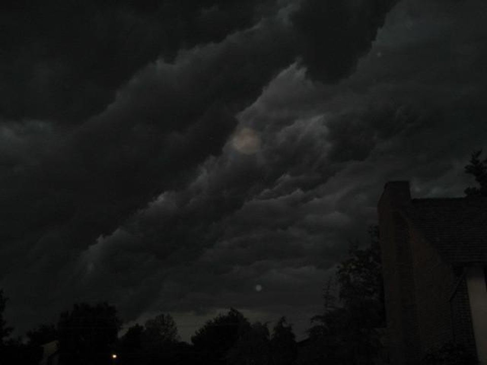 This was taken over my home in Enid, Friday, May 15, 2009. The clouds were actually 'boiling'.