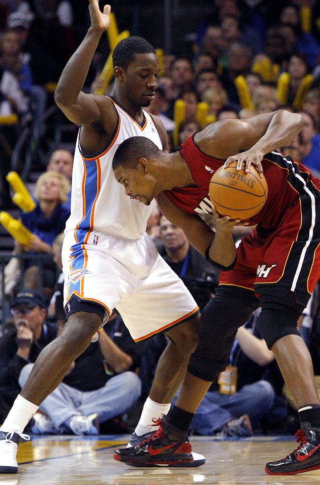 Photo - Oklahoma City's Jeff Green pressures Miami's Chris Bosh during their NBA basketball game at the OKC Arena in Oklahoma City on Thursday, Jan. 30, 2011. The Heat beat the Thunder 108-103. Photo by John Clanton, The Oklahoman
