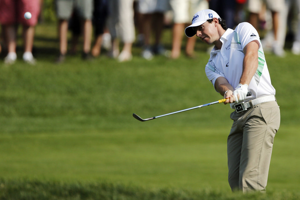 Photo -   Rory McIlroy, of Northern Ireland, hits onto the seventh green during the third round of the Deutsche Bank Championship PGA golf tournament at TPC Boston in Norton, Mass., Sunday, Sept. 2, 2012. (AP Photo/Michael Dwyer)