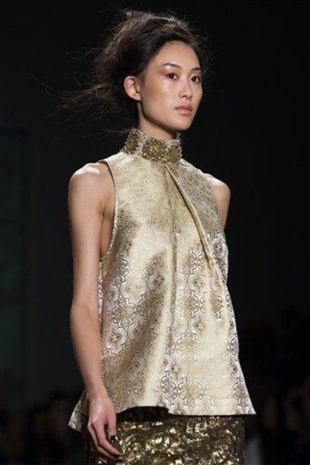 The Vera Wang Spring 2013 collection is modeled during Fashion Week in New York, Tuesday, Sept. 11, 2012. (AP Photo/John Minchillo)