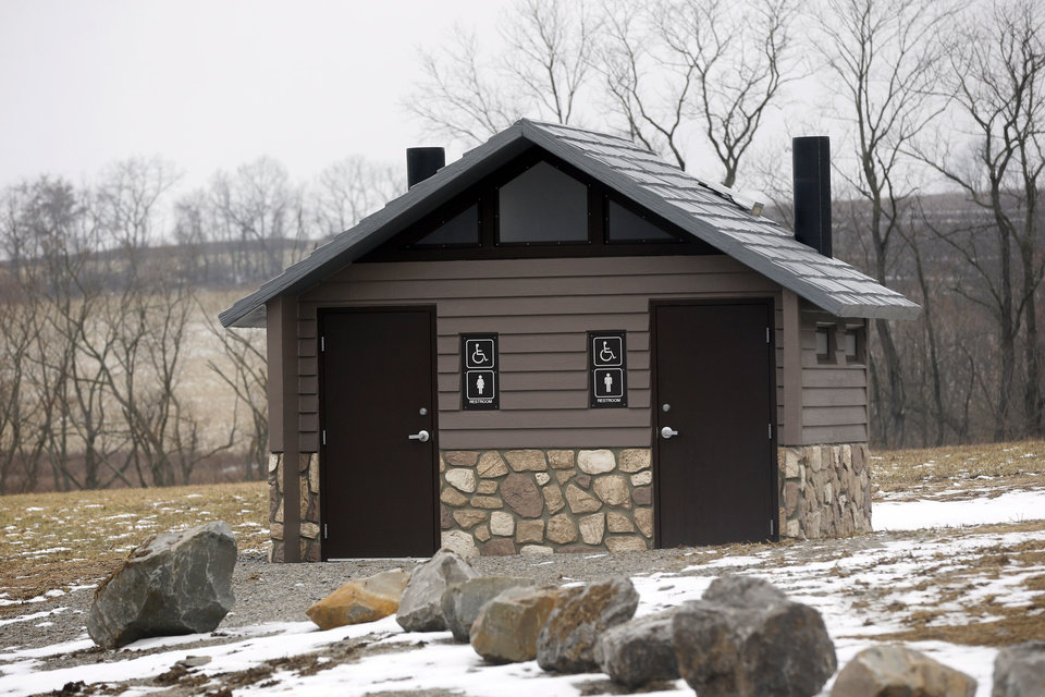 Photo - In this Friday, Jan. 10, 2014 photo, a new public restroom that was bought with money from gas well royalties is available at the new Lynn Portal Access Area in the Washington County Cross Creek County Park in Avella, Pa. Local officials say the deals have worked well, and that they have few other options to generate new funds. But some residents don't like drilling taking place under public land. (AP Photo/Keith Srakocic)