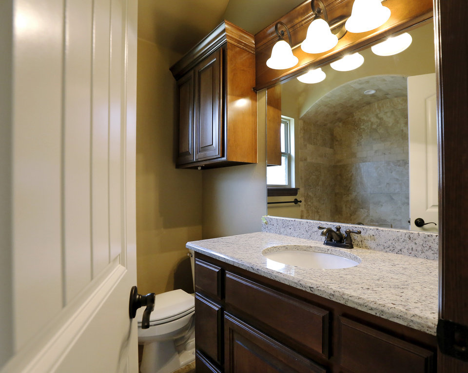 Photo - Master bath at 8813 NW 10, a house built by Jason Powers from a Bill Perry design.  PHOTO BY JIM BECKEL, THE OKLAHOMAN  Jim Beckel -  THE OKLAHOMAN