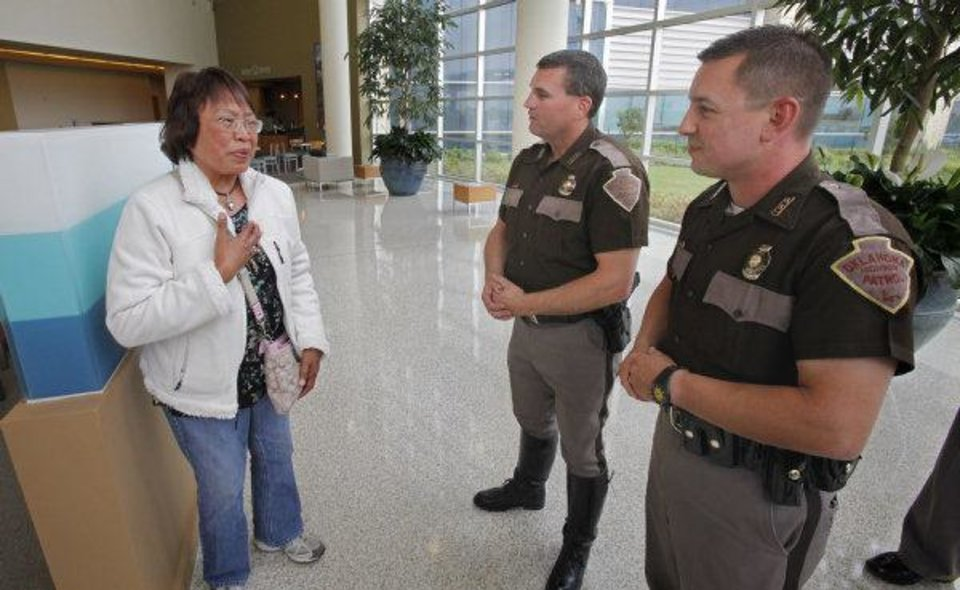 Nenita Mijares thanks Highway Patrol Troopers Steve Johnson (center) and Ken Pittman at the Norman Regional Healthplex on Thursday, April 21, 2011, in Norman, Okla. The troopers performed CPR on her husband Hector Mijares, a retired commercial airline pilot, while working a multi-vehicle accident at Interstate 35 and 27th Street in Moore, OK. The couple are living in Oklahoma City after retiring in the Philippines. Photo by Steve Sisney, The Oklahoman ORG XMIT: KOD