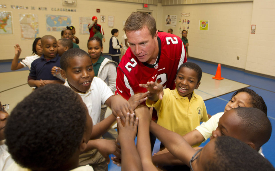 Atlanta Falcons quarterback Matt Ryan (2) plays with student at Clifton elementary School in Atlanta, Tuesday, Oct. 9, 2012. Several Falcons spent the morning visiting area schools as part of the NFL's Hometown Huddle volunteer program. (AP (AP Photo/John Bazemore)