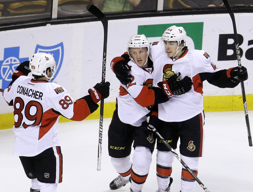 Photo - Ottawa Senators right wing Erik Condra (22) celebrates with left wing Cory Conacher (89) and center Jean-Gabriel Pageau (44) after scoring in the first period of an NHL hockey game against the Boston Bruins in Boston, Sunday, April 28, 2013. The Senators won 4-2. (AP Photo/Steven Senne)