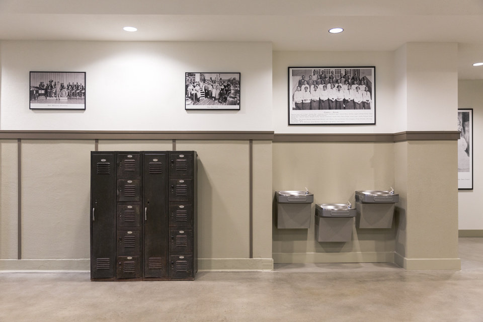 Photo -  Original lockers from Douglass High School are displayed in the hallways of the Douglass at Page Woodson. Photos from when the school was still the city's primary high school for the city's African American community adorn the hallways and common areas. [Photo by Dustin Clemons]
