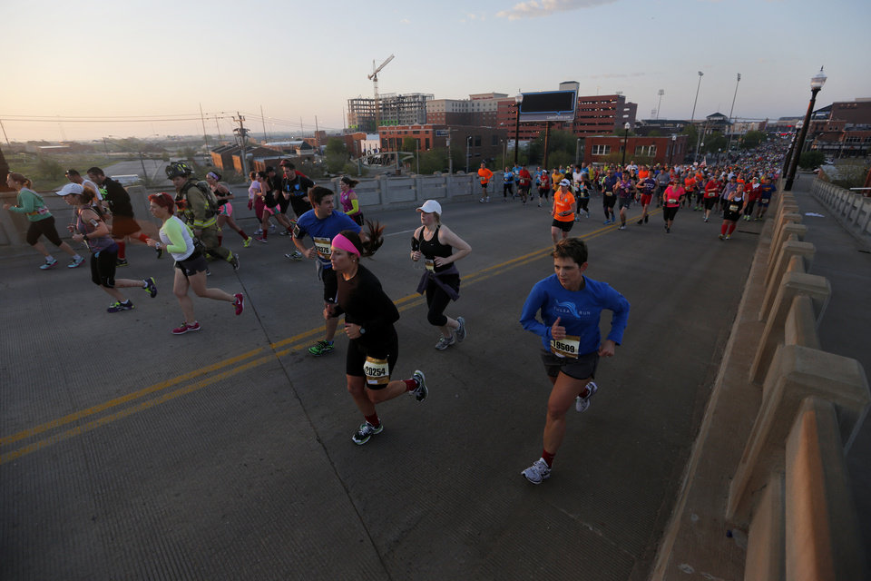 Photo - Runners make their way north on the Walnut Ave. bridge during the Oklahoma City Memorial Marathon in Oklahoma City, Sunday, April 28, 2013.  Photo by Garett Fisbeck, For The Oklahoman