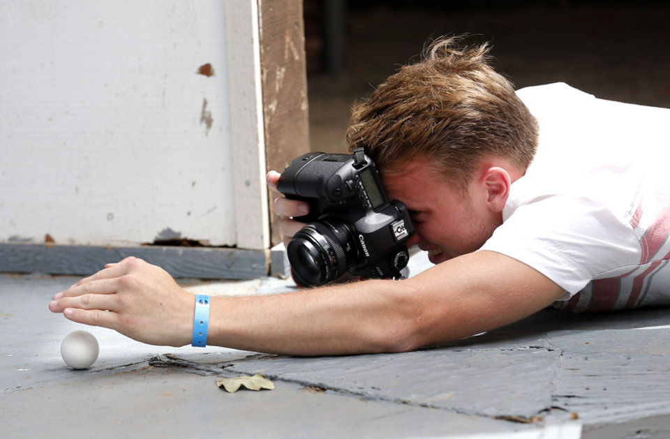 Photo - Jonathan Burkhart of Choctaw shoots photographs of an egg for a class assignment during the Oklahoma Summer Arts Institute at Quartz Mountain Arts and Conference Center near Lone Wolf on Monday, June 17, 2013. PHOTO BY SARAH PHIPPS, The Oklahoman  SARAH PHIPPS