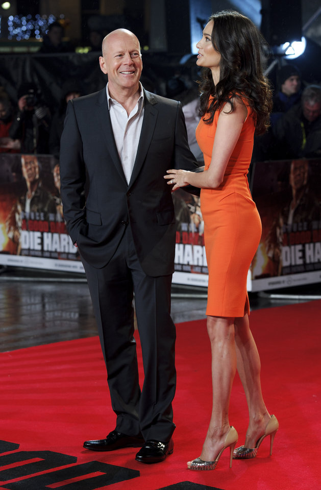 Photo - FILE - In this Thursday, Feb. 7, 2013 file photo, U.S. actor Bruce Willis, left, and British actress Emma Heming arrive for the British premiere of  the film,