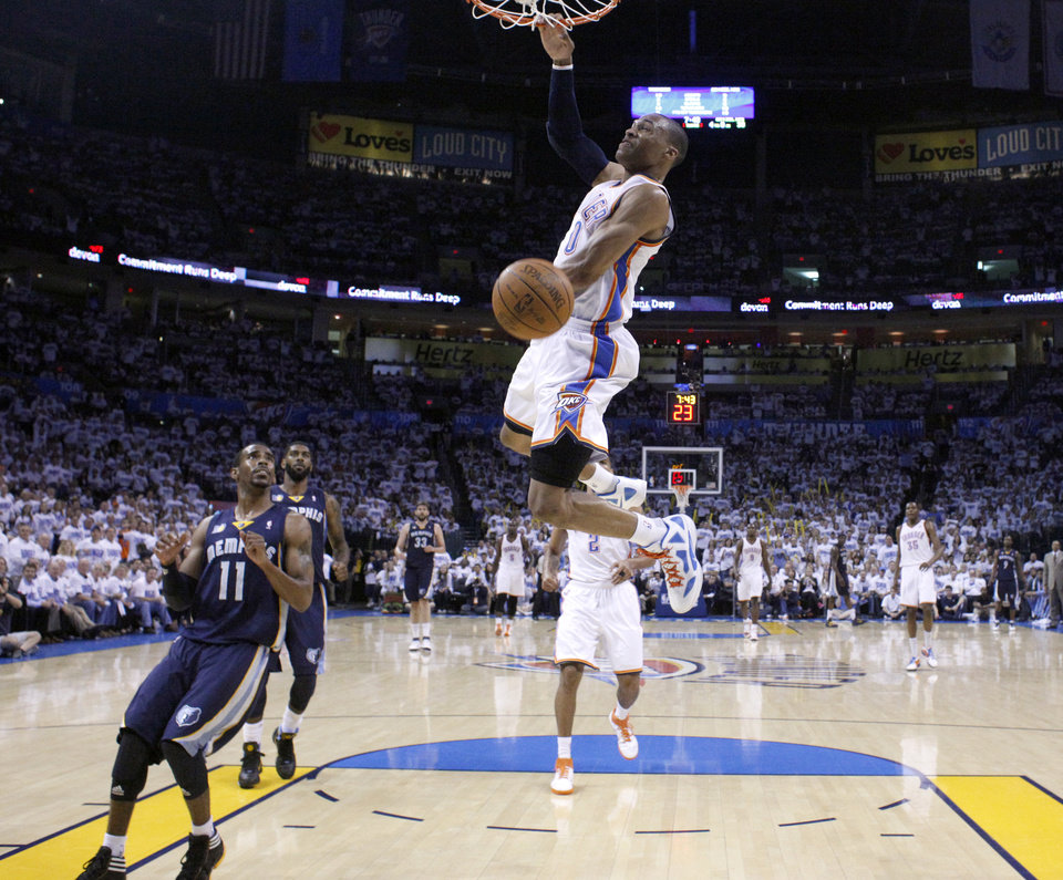 Oklahoma City\'s Russell Westbrook (0) dunks during game five of the Western Conference semifinals between the Memphis Grizzlies and the Oklahoma City Thunder in the NBA basketball playoffs at Oklahoma City Arena in Oklahoma City, Wednesday, May 11, 2011. Photo by Sarah Phipps, The Oklahoman