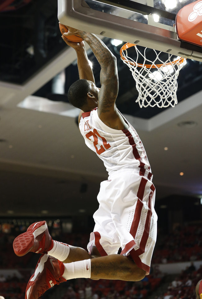 Photo - Oklahoma Sooner's Cameron Clark (21) completes the alley-oop play as the University of Oklahoma Sooners (OU) men play the Iowa State Cyclones (ISU) in NCAA, college basketball at The Lloyd Noble Center on Saturday, Jan. 11, 2014  in Norman, Okla. Photo by Steve Sisney, The Oklahoman