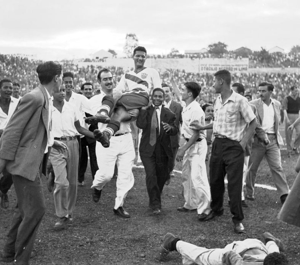 Photo - FILE - In this June 29, 1950 file photo, U.S. centre forward Joe Gaetjens is carried off by cheering supporters, after his team beat England 1-0, in their World Cup qualifier soccer match at Belo Horizonte, Brazil. On this day: US shocks England to win 1-0. (AP Photo/File)