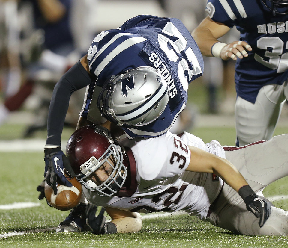 Photo - Edmond Memorial's Jason Hand, bottom, and Josh Reinhart of Edmond North fight for the ball after a blocked punt during a high school football playoff game at Wantland Stadium in Edmond, Okla., Thursday, Nov. 8, 2012. North recovered the ball on the play. Photo by Bryan Terry, The Oklahoman