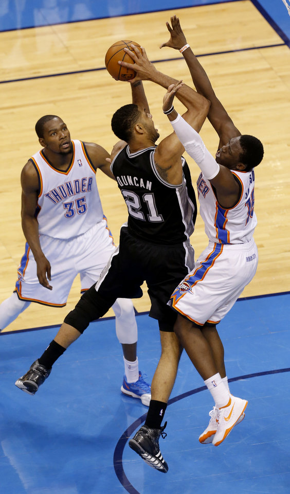 Photo - Oklahoma City's Reggie Jackson (15) defends against San Antonio's Tim Duncan (21) as Oklahoma City's Kevin Durant (35) looks on during Game 3 of the Western Conference Finals in the NBA playoffs between the Oklahoma City Thunder and the San Antonio Spurs at Chesapeake Energy Arena in Oklahoma City, Sunday, May 25, 2014. Photo by Nate Billings, The Oklahoman