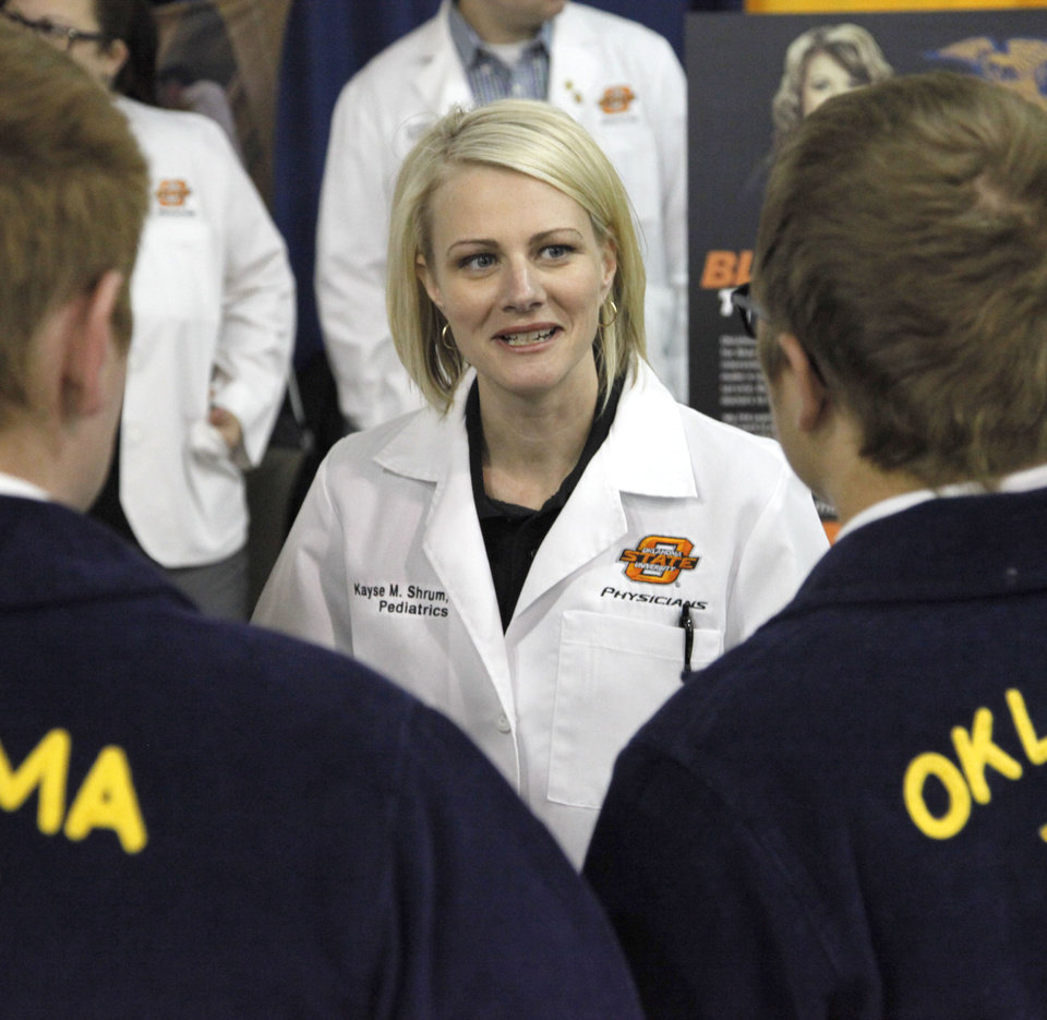 Photo - Kayse Shrum, President of the OSU Health Sciences Center, speaks to students at the FFA event at the Cox Convention Center in Oklahoma City, OK, about going into medicine. Tuesday, April 29, 2014,  Photo by Paul Hellstern, The Oklahoman