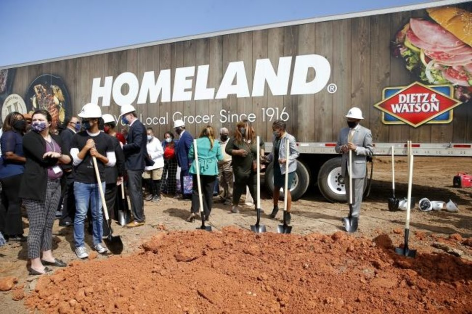 Photo -  Dignitaries stand by shovels after posing for a photo during the groundbreaking for a new Homeland grocery store at the corner of NE 36 and Lincoln Boulevard in Oklahoma City Thursday.  [Bryan Terry/The Oklahoman]