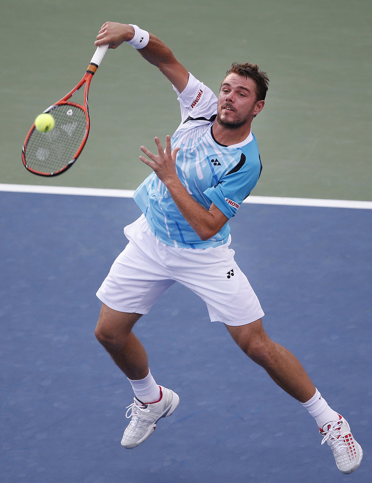 Photo - Stan Wawrinka, of Switzerland, returns a shot to Tommy Robredo, of Spain, during the fourth round of the U.S. Open tennis tournament Monday, Sept. 1, 2014, in New York. (AP Photo/Jason DeCrow)