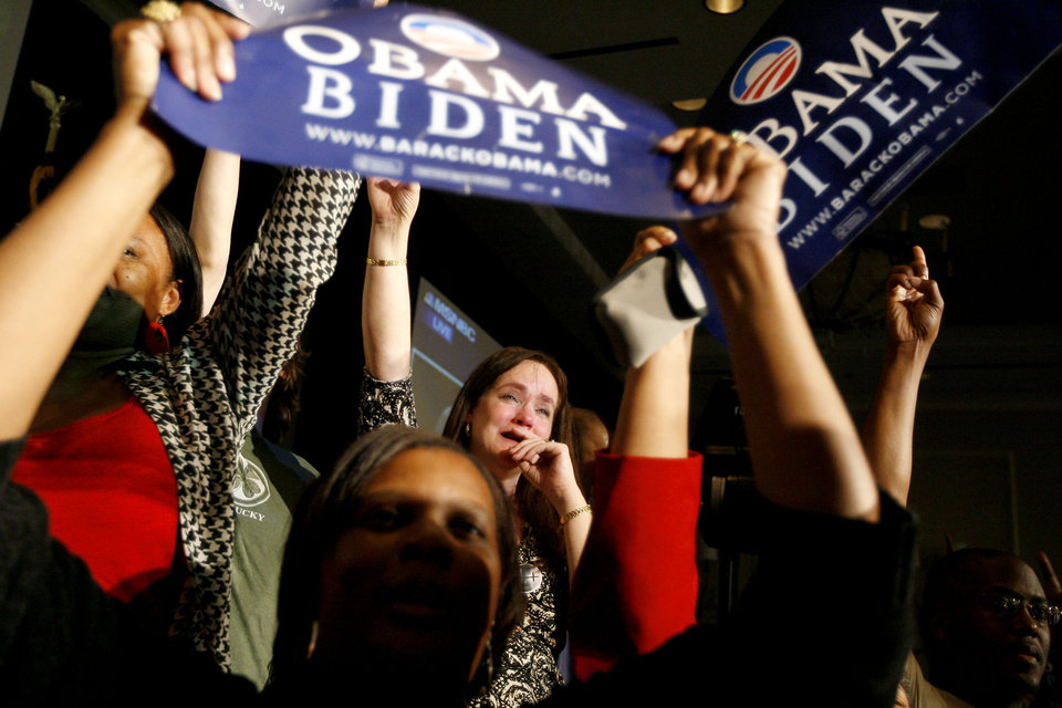 Photo - Neva Hames of Norman celebrates during the Democratic watch party for the presidential election in Oklahoma City, Tuesday, November 4, 2008. BY BRYAN TERRY, THE OKLAHOMAN