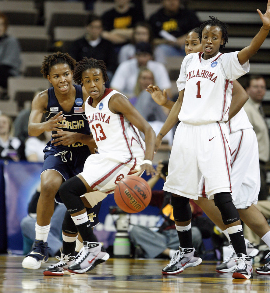 Photo - Danielle Robinson (13) and Nyeshia Stevenson (1) eye a bad pass by Deja Foster (23) in the second half as the University of Oklahoma (OU) plays Georgia Tech in round two of the 2009 NCAA Division I Women's Basketball Tournament at Carver-Hawkeye Arena at the University of Iowa in Iowa City, IA on Tuesday, March 24, 2009. 