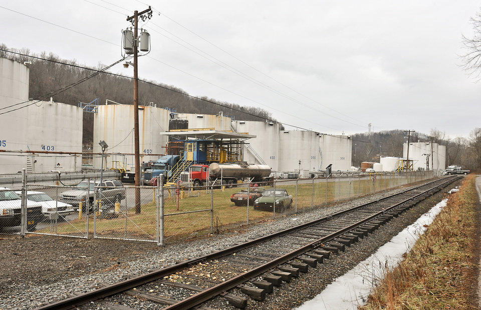 Photo - Freedom Industries, a chemical storage facility, in Charleston, W.Va., is shown on Friday, Jan. 10, 2014. A chemical leak at the plant on Thursday has prompted a state of emergency for parts of nine West Virginia counties after contaminating water that was taken in from the nearby Elk River. (AP Photo/Charleston Daily Mail, Bob Wojcieszak)