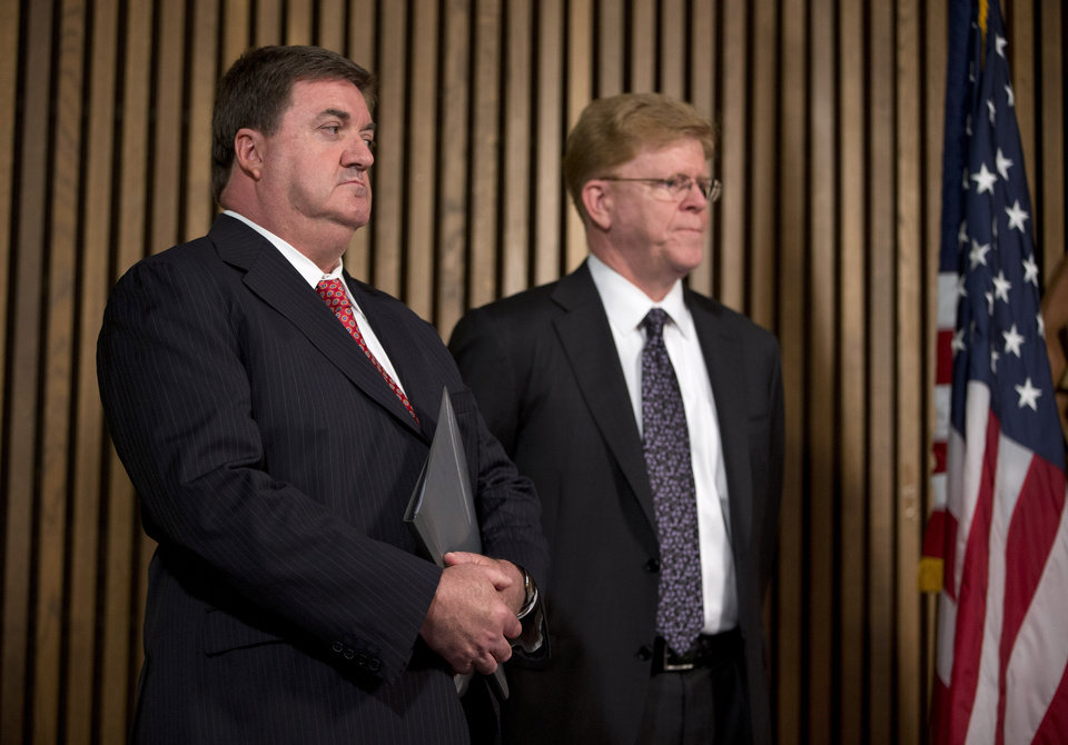 Photo - John Ryan, CEO of National Center for Missing and Exploited Children, left, and Drew Oosterbaan, chief of the DOJ Child Exploitation and Obscenity Section look on during a news conference at FBI headquarters in Washington, Monday, July 29, 2013, to discuss