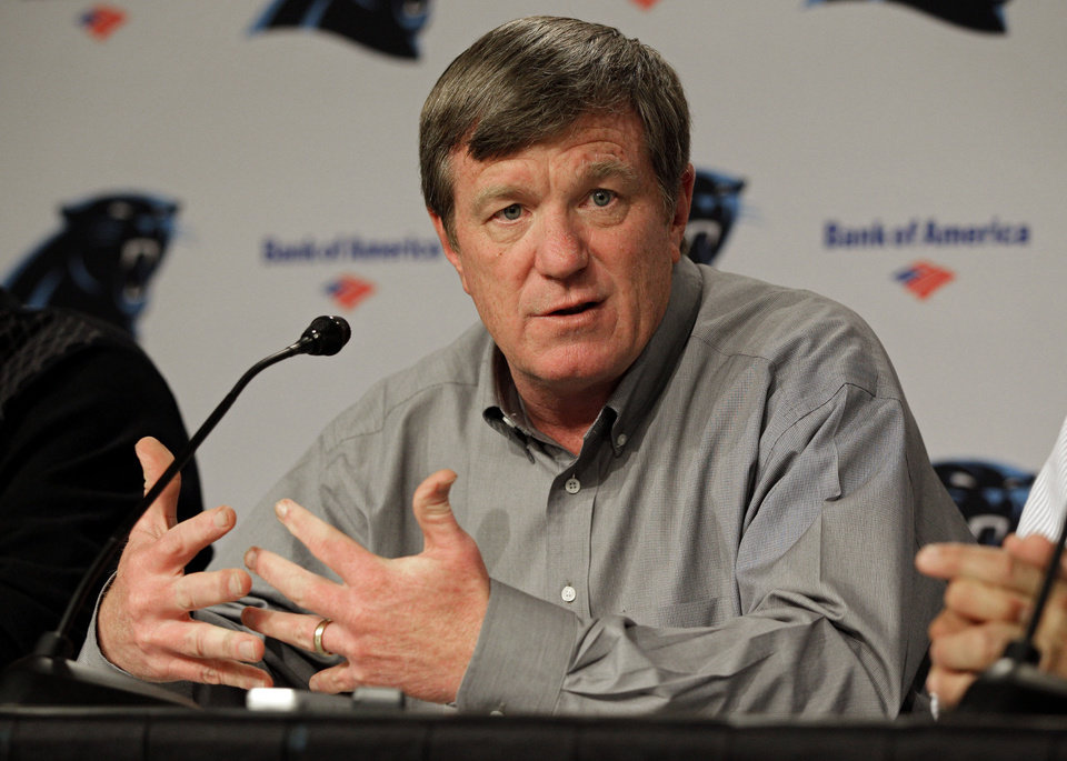Photo -   FILE - In this April 19, 2012 file photo, Carolina Panthers general manager Marty Hurney answers a question during a pre-draft news conference for the NFL football team in Charlotte, N.C. The Panthers fired Hurney Monday, Oct. 22, 2012, following the team's 1-5 start this season. (AP Photo/Chuck Burton, File)