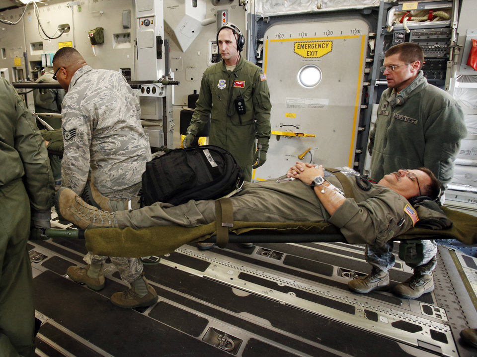 Air Natiional Guard flight nurses and medical technicians from Mississippi, Tennessee, Colorado and Oklahoma load mock evacuee Sr. MSG James Owens onto a C17 during the 137th Air Refueling Wing Aeromedical Evacuation Training Exercise known as Multiple Aircraft Training Opportunity Program (MATOP) on Saturday, Nov. 17, 2012 in Oklahoma City, Okla.  MATOP has been designed to help AE units from across the United States prepare for Natural Disasters and future deployments.  Photo by Steve Sisney, The Oklahoman