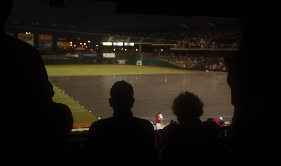 Fans wait out a rain delay of the Oklahoma City RedHawks and Omaha Royals at the At&T Bricktown Ballpark, Saturday July 4, 2009, in Oklahoma City. Photo by Sarah Phipps, The Oklahoman