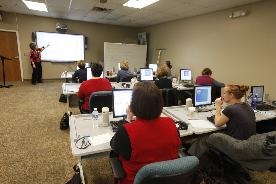 Photo - Susan Sawyer teaches a class on how to use a SMARTboard in Edmond, Oklahoma January 13, 2010. Photo by Steve Gooch, The Oklahoman ORG XMIT: KOD