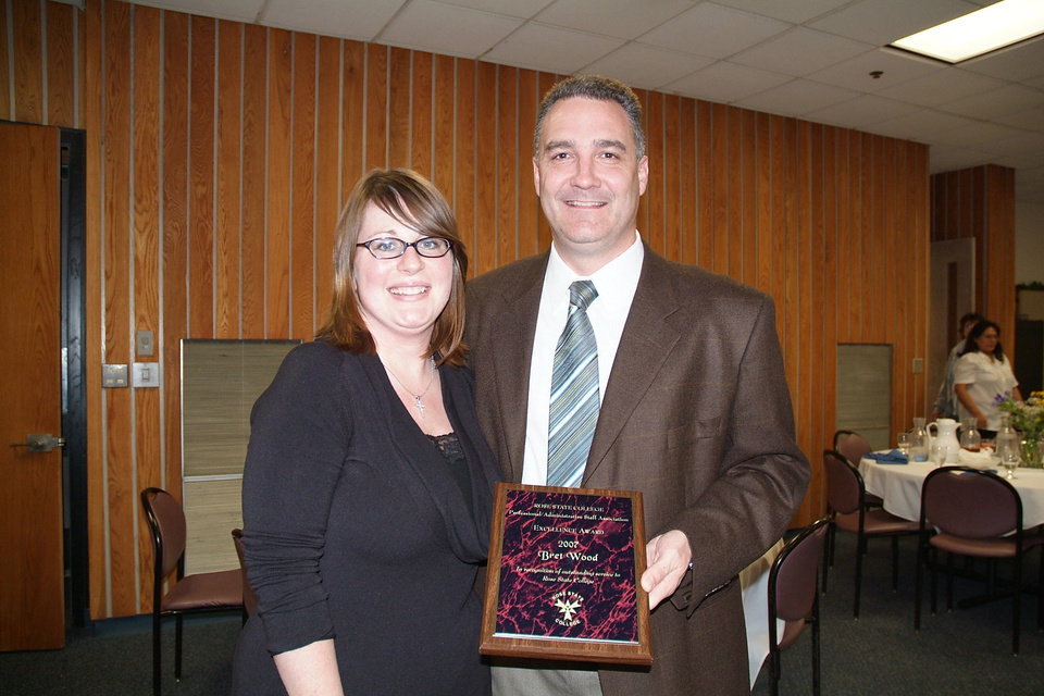 The Rose State College Professional/Administrative Staff Association (PASA) has named Dean of Continuing Education Dr. Bret Wood the PASA Member of the Year. Wood received a plaque and $1,000. Wood is pictured with Continuing Education Coordinator Stephanie Scott who nominated him for the award.<br/><b>Community Photo By:</b> Steve Reeves<br/><b>Submitted By:</b> Donna, Choctaw